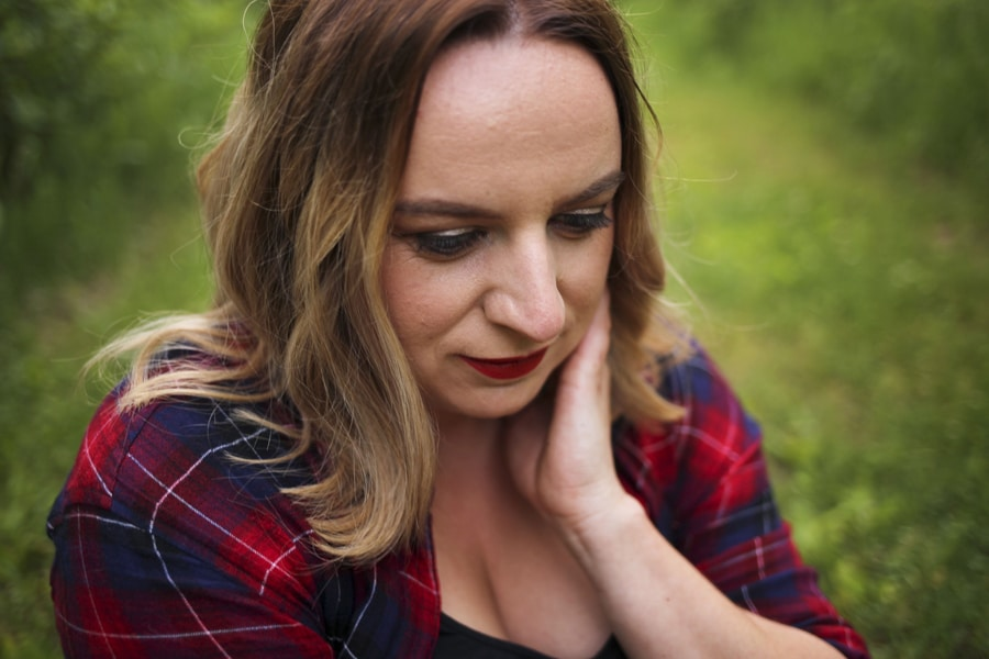 close-up portrait of woman in plaid shirt
