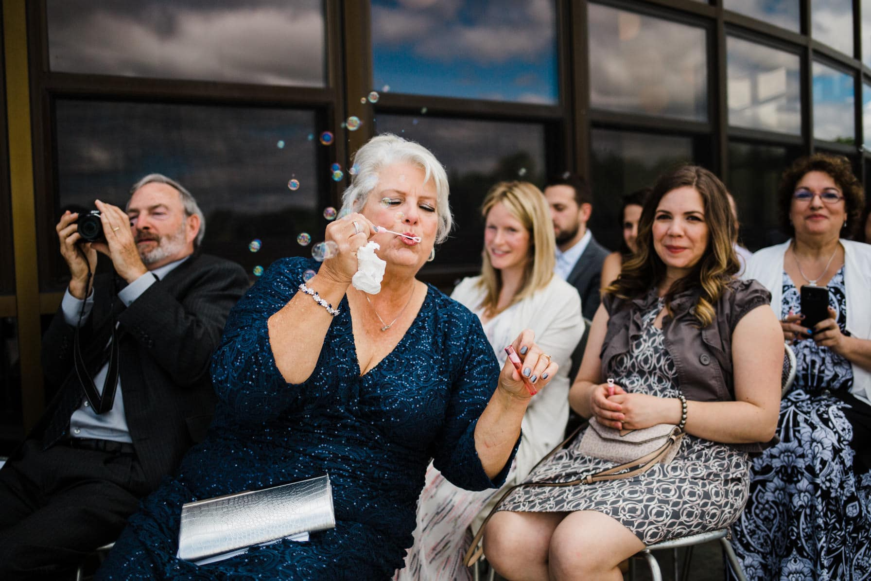 Lago Bar and Grill Wedding - Guests blow bubbles
