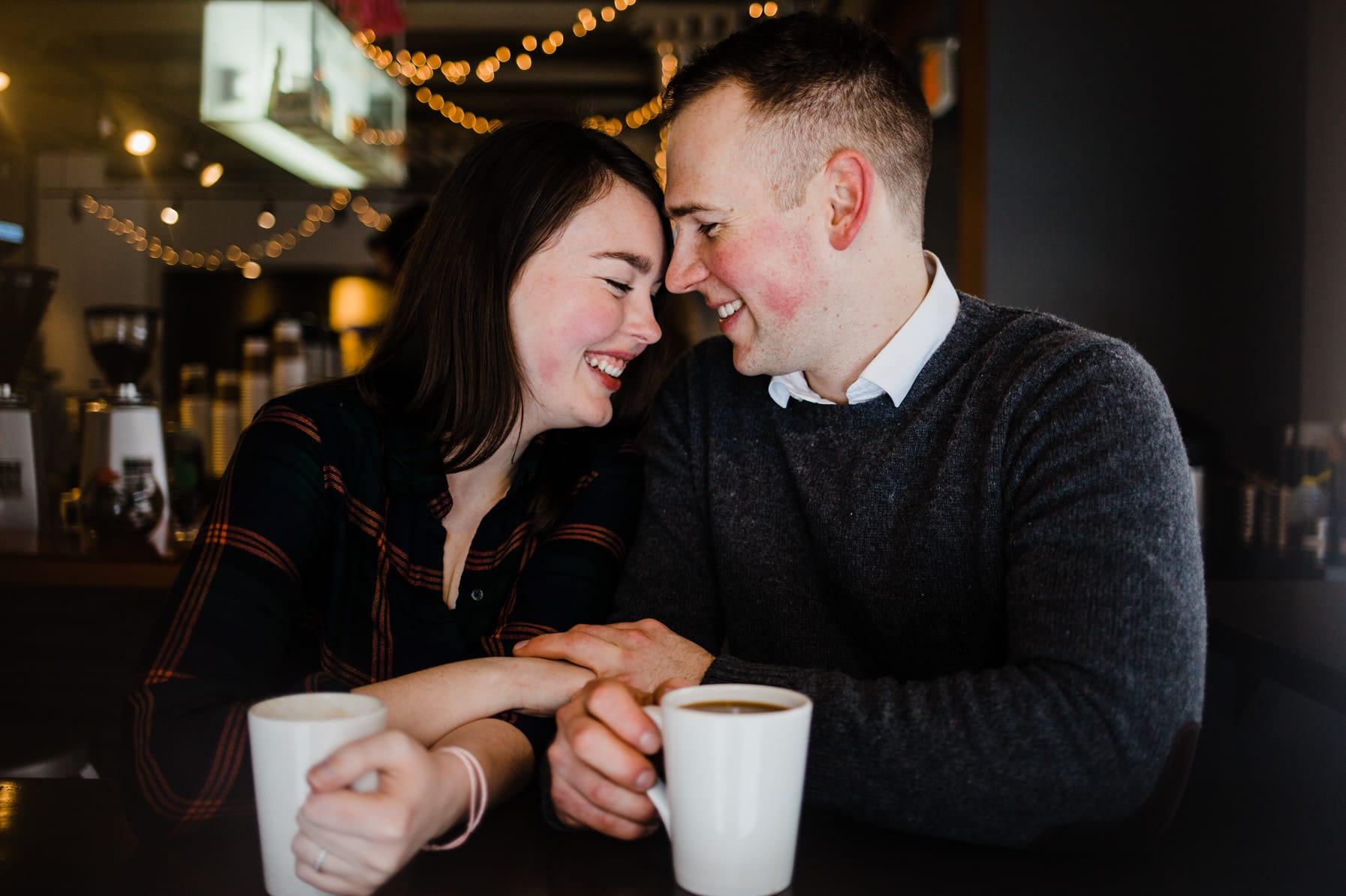 Downtown Ottawa Engagement Session - Couple have coffee together