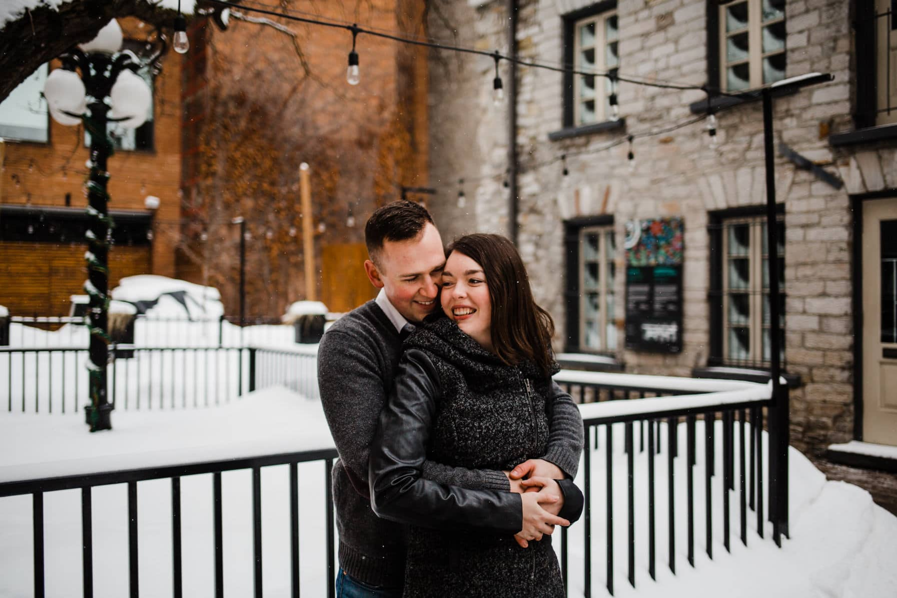 Downtown Ottawa Engagement Session - Couple laugh together outdoors