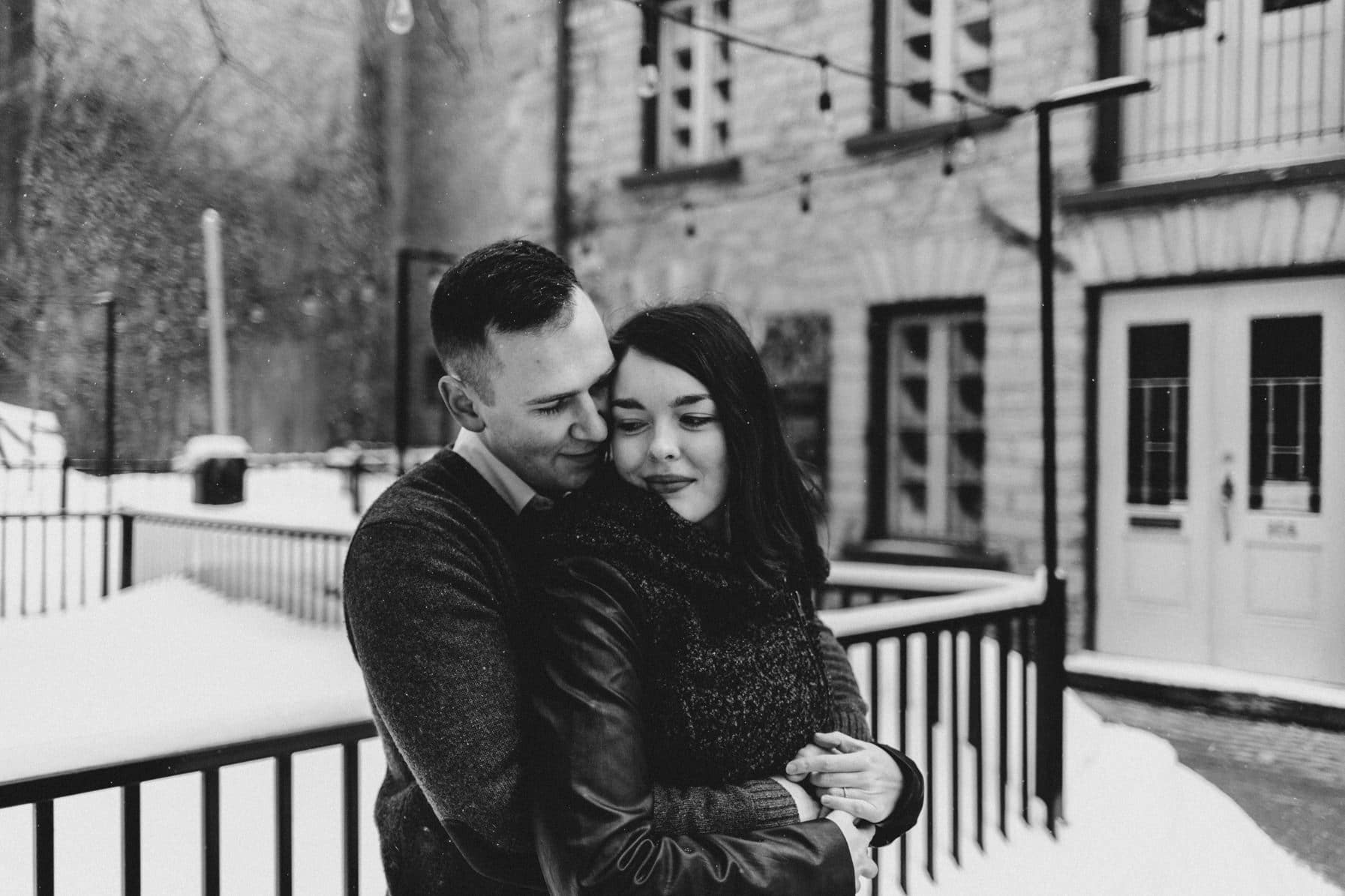 Downtown Ottawa Engagement Session - Couple embrace in Byward Market