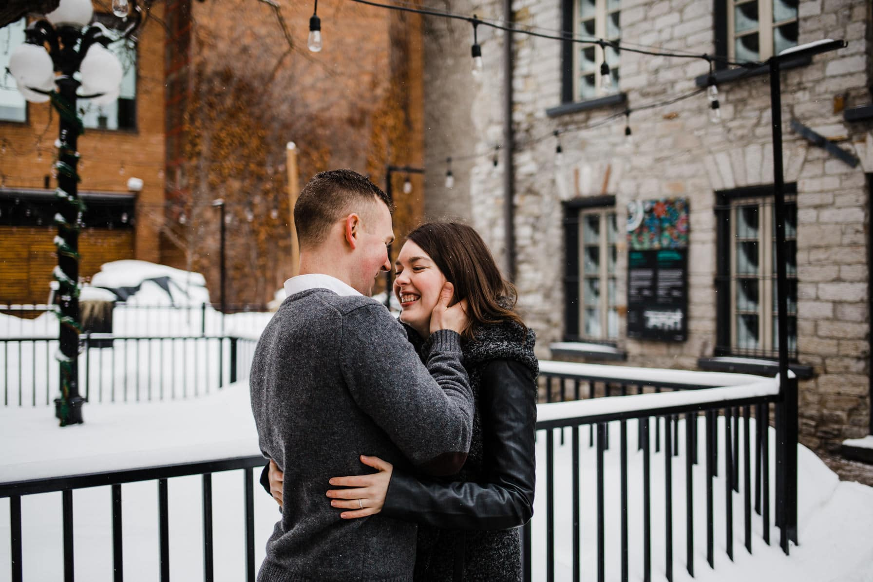 Downtown Ottawa Engagement Session - Couple laugh in Byward Market