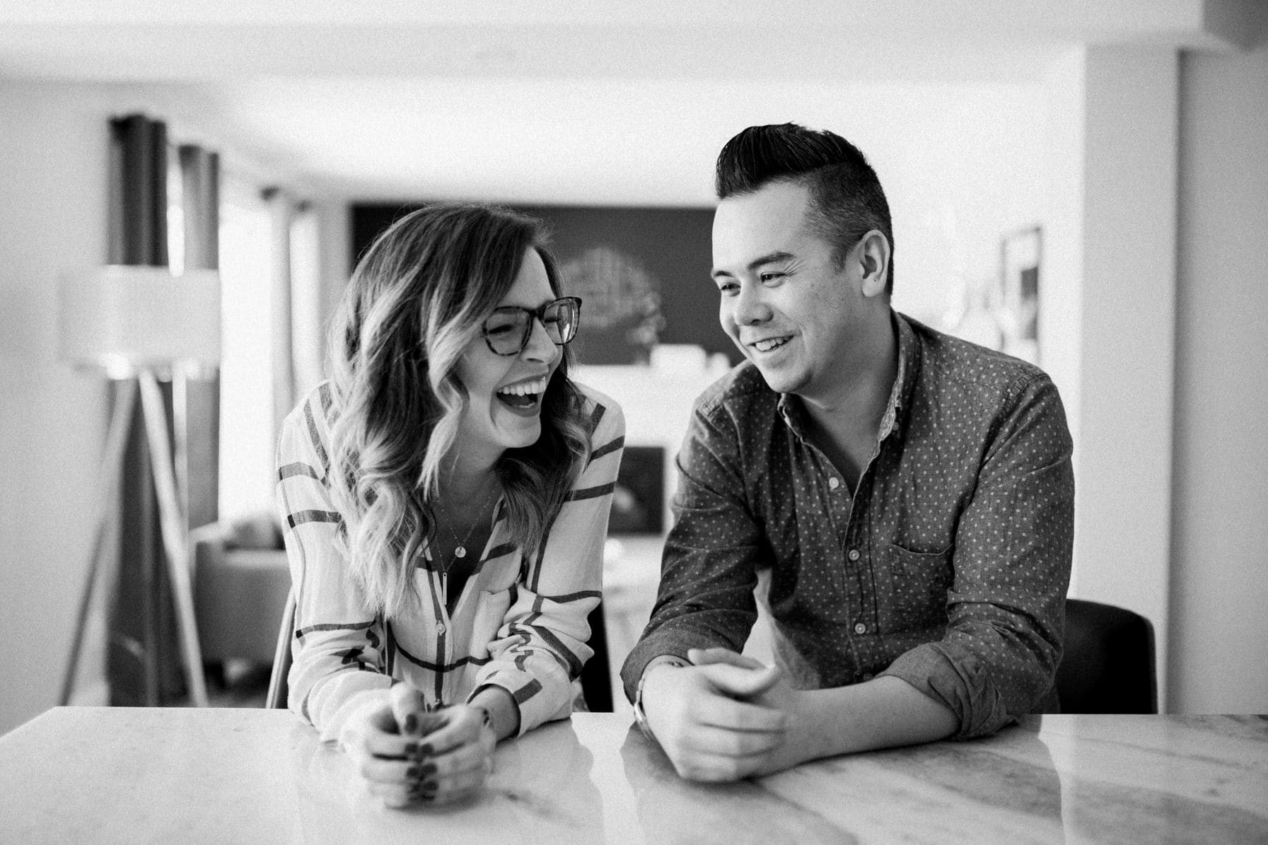 Couple laugh in home - Cozy At-Home Photos Lifestyle