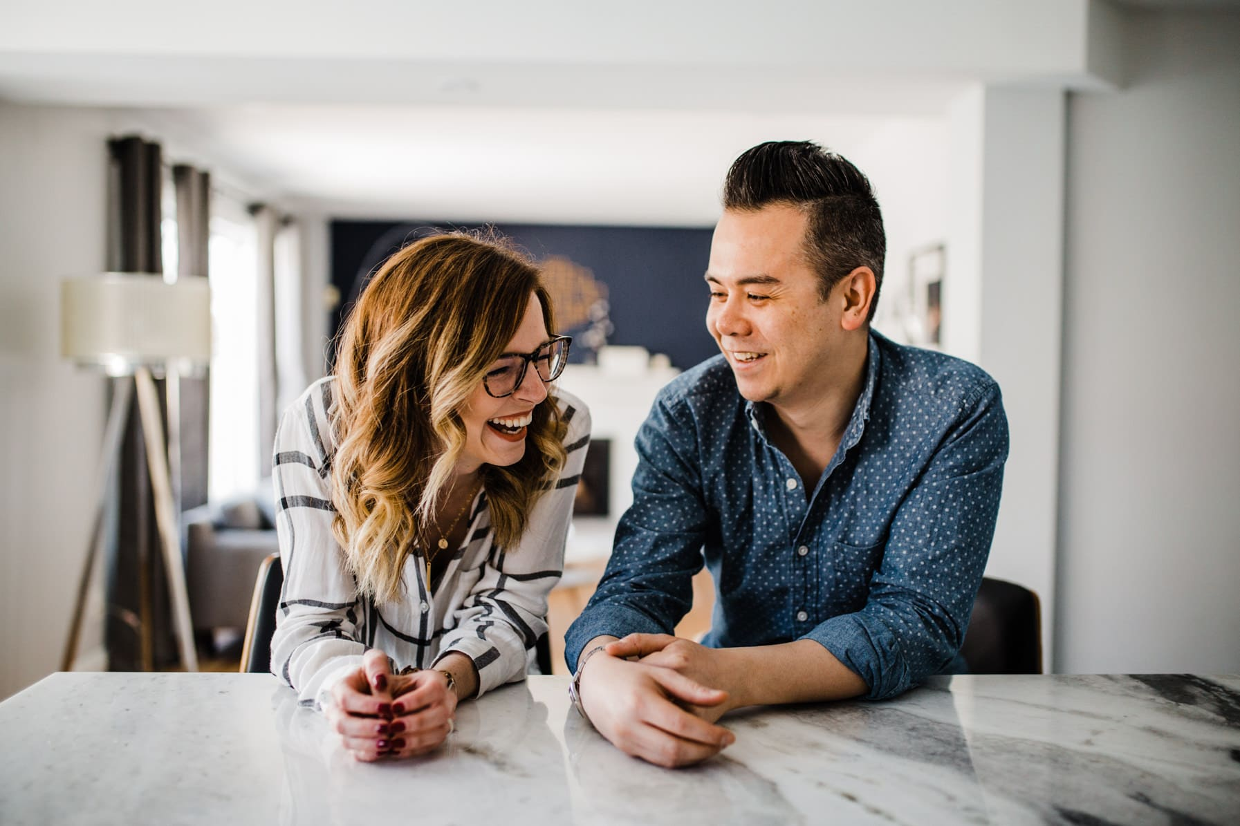 Couple laugh together in kitchen - Cozy At-Home Photos Lifestyle