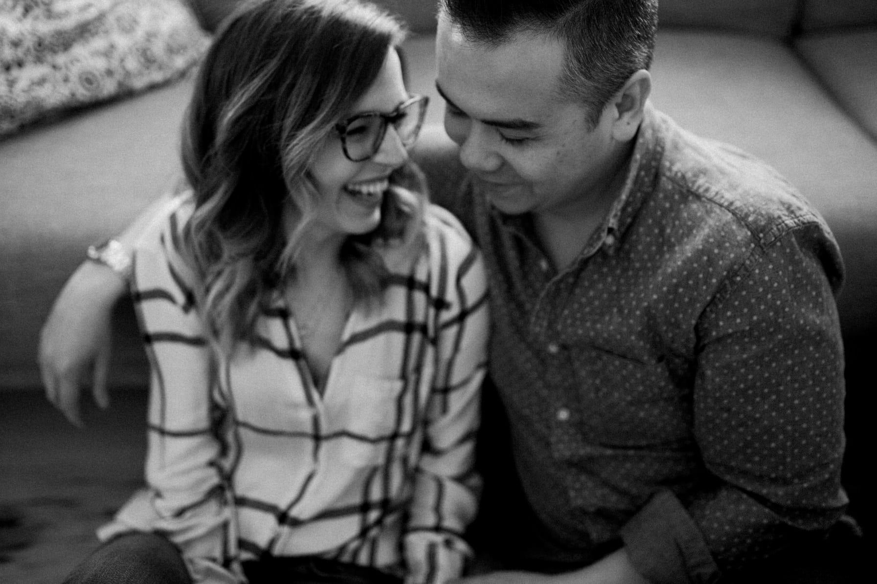 Couple laugh in living room - Cozy At-Home Photos Lifestyle