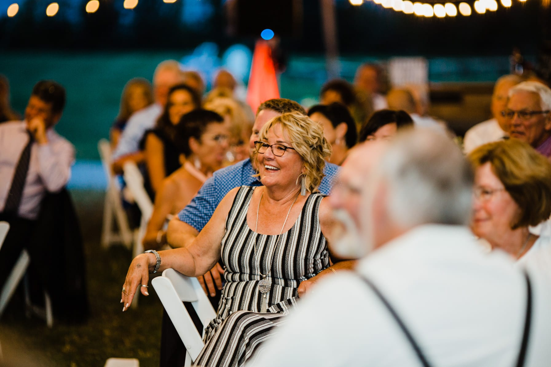 guests react to speeches - summer farm wedding
