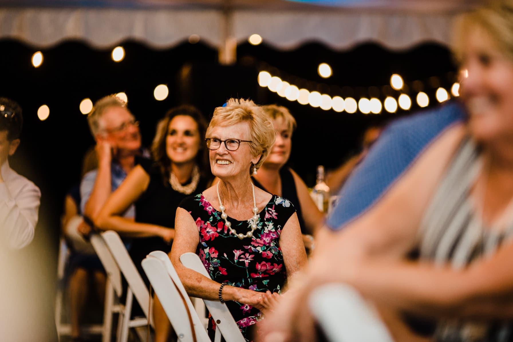 guests listen to speeches - summer farm wedding
