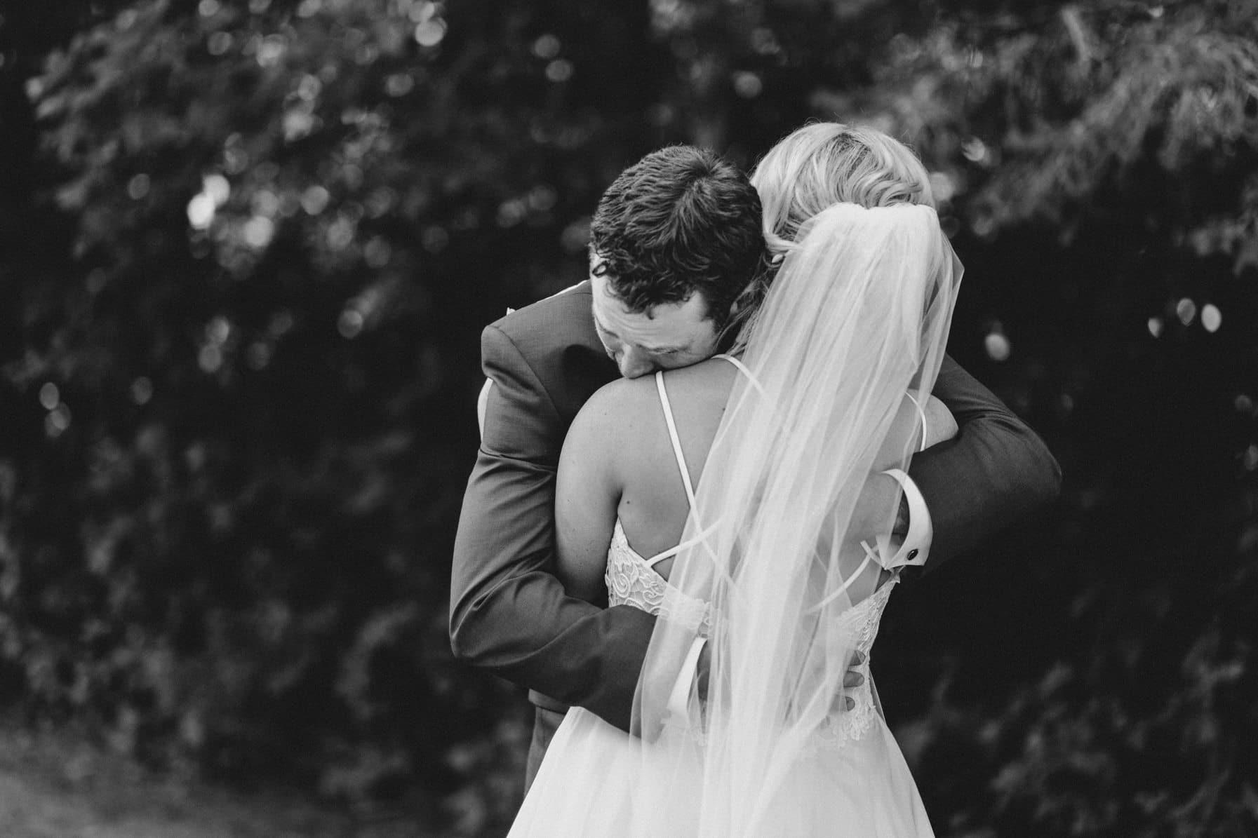 emotional first look - summer farm wedding