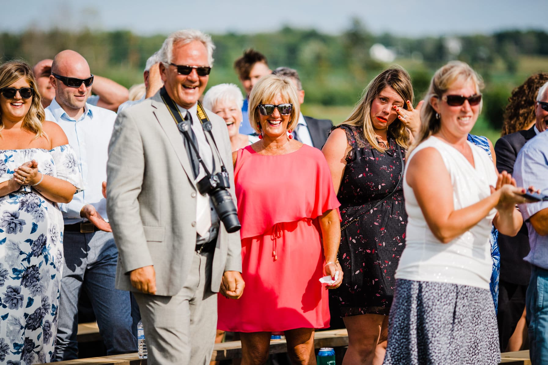 guests laughing - summer farm wedding