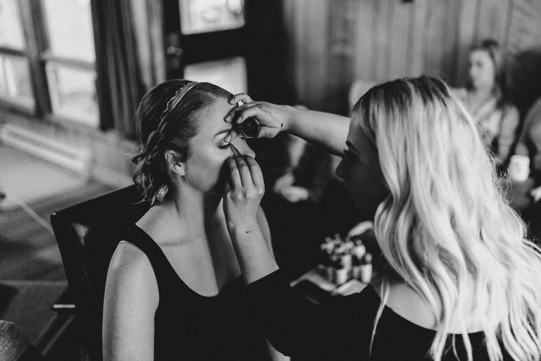 bride has makeup done summer camp wedding