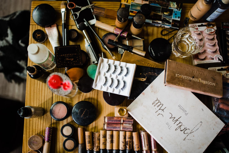 makeup cluttered table summer camp wedding