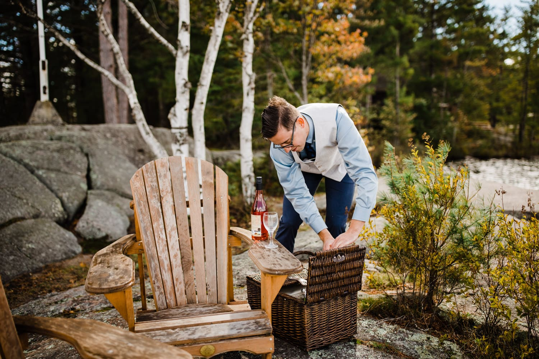 groom prepares first look picnic summer camp wedding