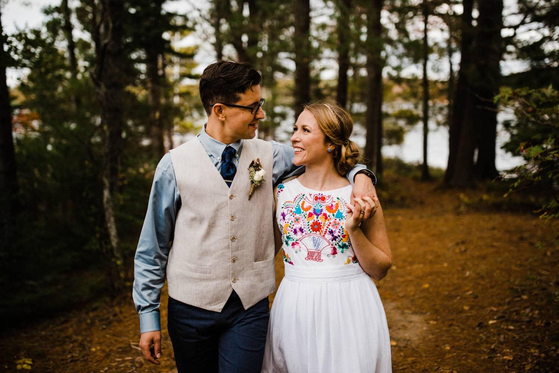 bride and groom walk together summer camp wedding
