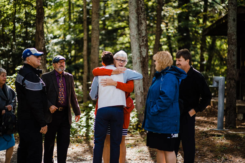 guests arrive at summer camp wedding