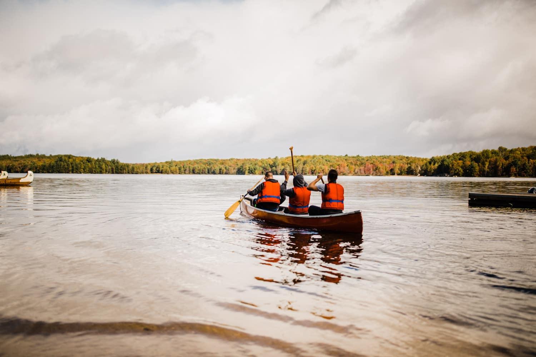 groom and groomsmen go for canoe ride at bark lake
