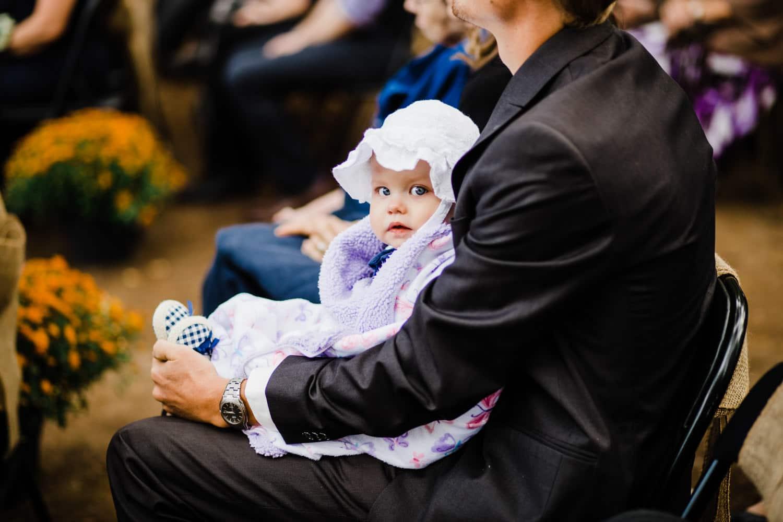 baby at summer camp wedding ceremony