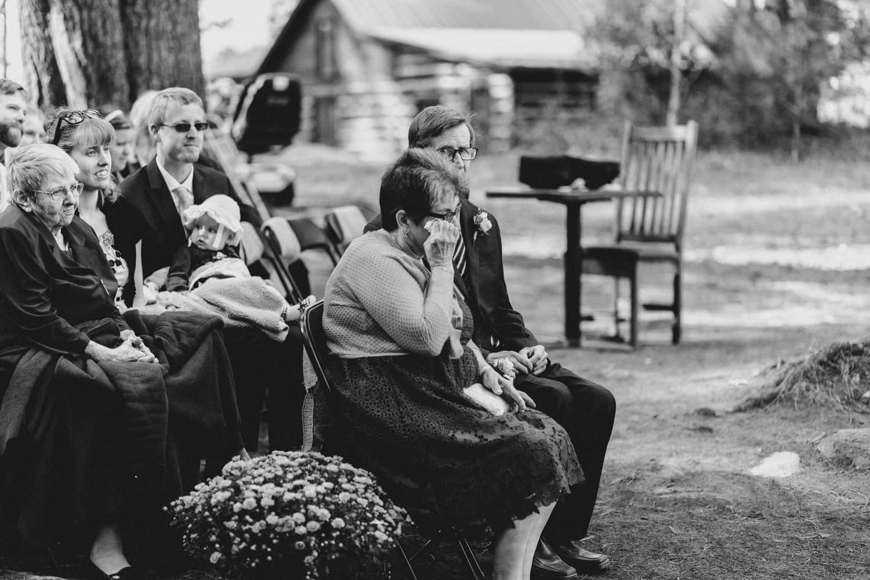 groom's mom wipes tear from her eye - summer camp wedding