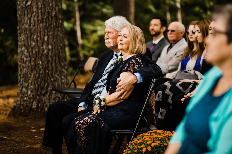 bride's parents listen to ceremony - summer camp wedding