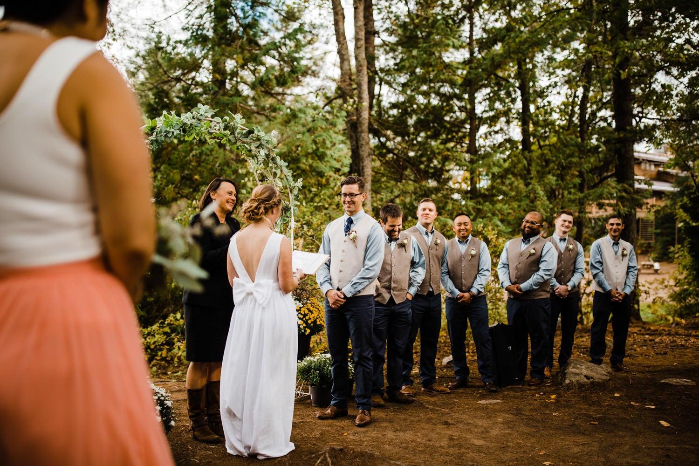 bride reads her vows - summer camp wedding