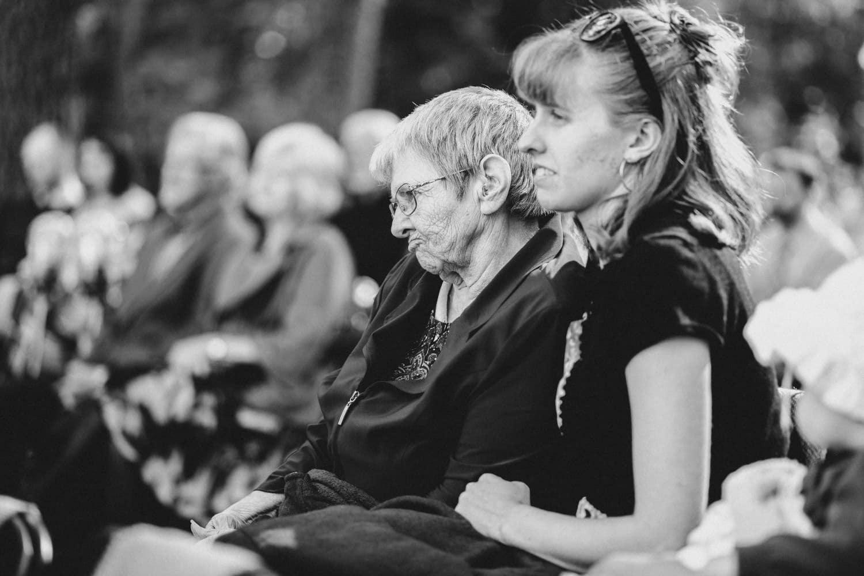 grandma listens to vows - summer camp wedding
