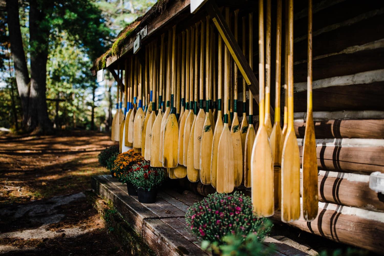 bark lake paddles at summer camp wedding