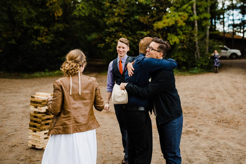 hugs after ceremony - summer camp wedding