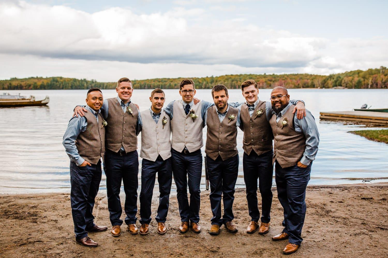 groom and groomsmen at bark lake summer camp wedding
