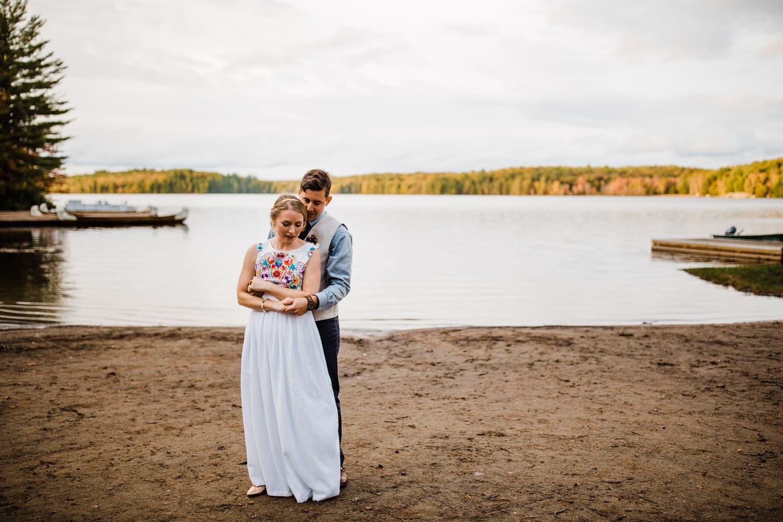 bride and groom dance on beach - summer camp wedding