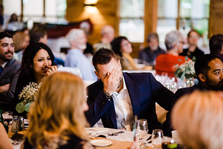 guests laugh at reception - summer camp wedding