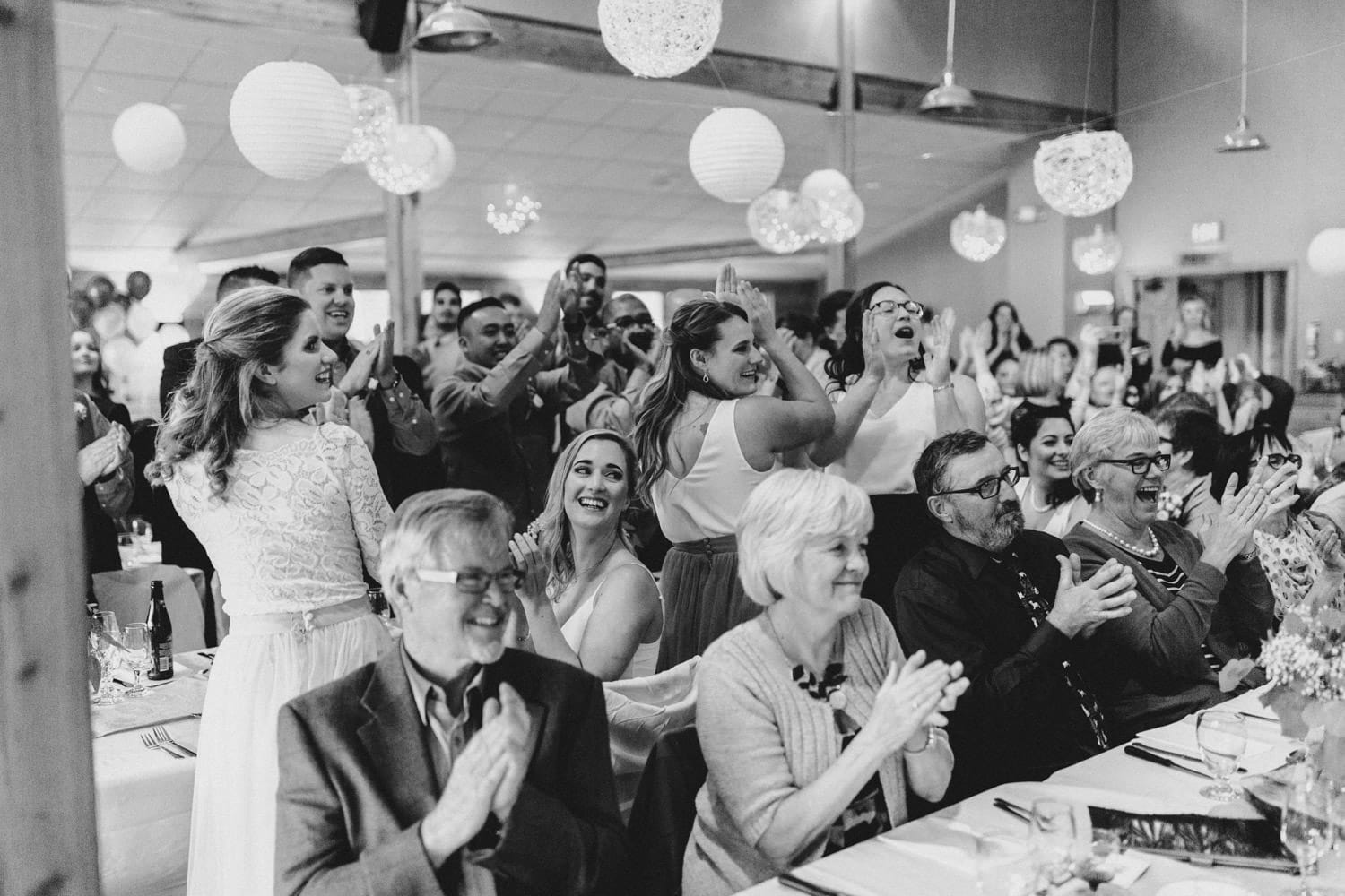 guests welcome bride and groom at summer camp wedding